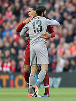 Liverpool's Alisson Becker (left) and Virgil van Dijk greet each other ahead of kick-off<br /> <br /> Photographer Rich Linley/CameraSport<br /> <br /> UEFA Champions League Semi-Final 2nd Leg - Liverpool v Barcelona - Tuesday May 7th 2019 - Anfield - Liverpool<br />  <br /> World Copyright &copy; 2018 CameraSport. All rights reserved. 43 Linden Ave. Countesthorpe. Leicester. England. LE8 5PG - Tel: +44 (0) 116 277 4147 - admin@camerasport.com - www.camerasport.com