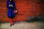 A woman checks her phone at the 49th Street station of the N train in Manhattan, New York on Sunday, December 27, 2009.