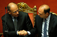 Il Presidente del Consiglio Enrico Letta stringe la mano al Ministro dell'Interno e Vicepresidente del Consiglio Angelino Alfano, a destra, dopo aver parlato in occasione del voto di fiducia sul suo governo al Senato, Roma, 2 ottobre 2013.<br /> Italian Premier Enrico Letta shakes hands with Interior Minister and Deputy Premier Angelino Alfano, right, after speaking in occasion of a confidence vote at the Senate, Rome, 2 October 2013.<br /> UPDATE IMAGES PRESS/Riccardo De Luca