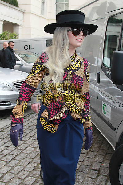 Lady Gaga (Stefani Joanne Angelina Germanotta) at the Lanesborough Hotel,.London, England..November 11th, 2011.half 3/4 length sunglasses shades hat blue skirt black  brown yellow pink jacket gloves purple .CAP/HIL.©John Hillcoat/Capital Pictures.