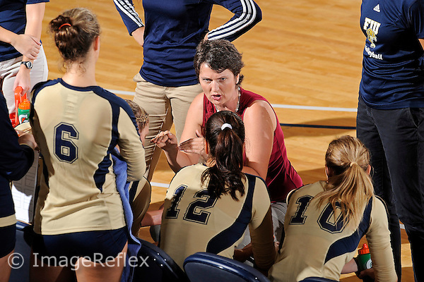 11 September 2011:  FIU Volleyball Head Coach Danijela Tomic speaks to her players during a time out in the first set as the FIU Golden Panthers defeated the Florida A&M University Rattlers, 3-0 (25-10, 25-23, 26-24), at U.S Century Bank Arena in Miami, Florida.