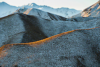 Snow patterns amongst native NZ tussock grasses on the Lindis Pass. Winter Central Otago New Zealand.