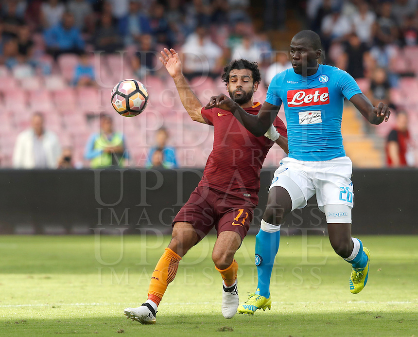 Calcio, Serie A: Napoli vs Roma. Napoli, stadio San Paolo, 15 ottobre. <br /> Roma's Mohamed Salah, left, and Napoli's Kalidou Koulibaly fight for the ball during the Italian Serie A football match between Napoli and Roma at Naples' San Paolo stadium, 15 October 2016. Roma won 3-1.<br /> UPDATE IMAGES PRESS/Isabella Bonotto