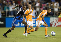 22 May 2008:  Ricardo Clark of the Dynamo dribbles the ball away from Ryan Johnson of the Earthquakes during the game at Buck Shaw Stadium in San Jose, California.   San Jose Earthquakes defeated Houston Dynamo, 2-1.