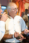 Parker Beam signing whiskey bottles at the 2011 Bourbon Festival in Bardstown, Ky. Mr. Beam is the master distiller for Heaven Hill Distilleries.