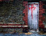Derelict doorway with graffiti