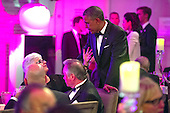 United States President Barack Obama talks to guest during a dinner for Medal of Freedom awardees at the Smithsonian National Museum of American History on November 20, 2013 in Washington, D.C.<br /> Credit: Kevin Dietsch / Pool via CNP