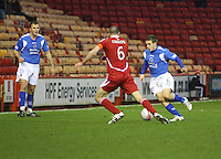 Danny Carmichael runs at Andrew Considine as Ryan McGuffie looks on in the Aberdeen v Queen of the South William Hill Scottish Cup 5th Round match played at Pittodrie Stadium, Aberdeen on 4.2.12.