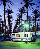 USA, California, motor home park and palms at sunset in Palm Springs