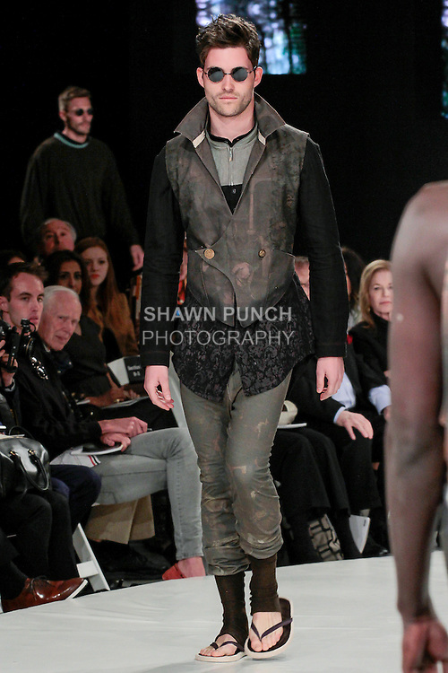 Model walks runway in an outfit by Alexandra Burns, during the 2013 Pratt Institute Fashion Show, on April 25, 2013.