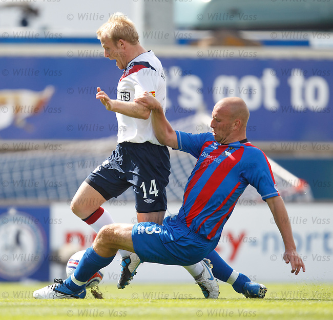 Ross Tokely takes out Steven Naismith for a penalty kick and a straight red card