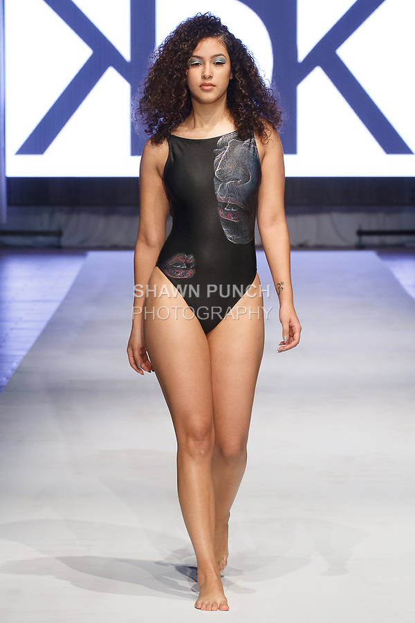 Model walks runway in a swimsuit from the Kovas Swim 2017 collection by Katie Kovas, at the Brooklyn EXPO Center on April 1, 2017 during Fashion Week Brooklyn Fall Winter 2017.