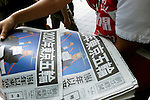 September 8th, 2013 : Tokyo, Japan - A vender gave out special editions of Asahi Newspaper as Tokyo was selected to host the 2020 Olympics and Paralympics at Shibuya Station, Shibuya, Tokyo, Japan on September 8, 2013. (Photo by Koichiro Suzuki/AFLO)