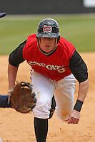 Zach Cozart of the Carolina Mudcats sliding head first versus the Huntsville Stars on April 22, 2009 at Five County Stadium in Zebulon, NC