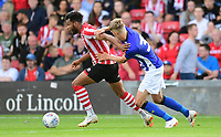 Lincoln City's Matt Green vies for possession with Sheffield Wednesday's Jack Lee<br /> <br /> Photographer Chris Vaughan/CameraSport<br /> <br /> Football Pre-Season Friendly - Lincoln City v Sheffield Wednesday - Friday 13th July 2018 - Sincil Bank - Lincoln<br /> <br /> World Copyright &copy; 2018 CameraSport. All rights reserved. 43 Linden Ave. Countesthorpe. Leicester. England. LE8 5PG - Tel: +44 (0) 116 277 4147 - admin@camerasport.com - www.camerasport.com
