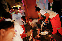 "Rescue workers and medics help an injured man at the site of a road accident during Songkran festival in Bangkok late April 13, 2013. Songkran or Thai New Year is known as a raucous party and touted as a popular tourist event. But officials also know it as ""the seven dangerous days"", when already high number of traffic related deaths and injuries surge. Thailand has the greatest number of road deaths in Southeast Asia per population, due to a combination of lax road laws and careless driving habits, experts say. REUTERS/Damir Sagolj (THAILAND)"