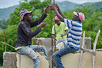 Workers in Jean-Rabel in northwestern Haiti work on reconstructing an elementary school that was heavily damaged during Hurricane Matthew in 2016. Church World Service, a member of the ACT Alliance, is helping the community repair the school.