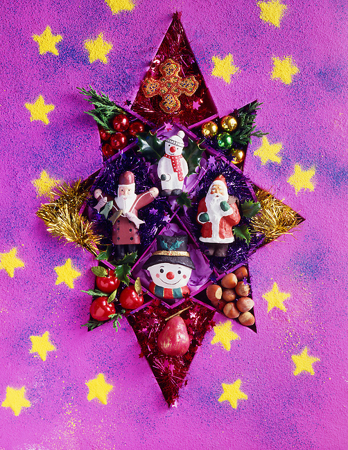 Christmas star made up of father christmas and snowmen.