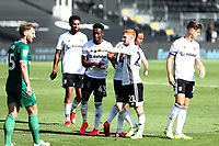 18th July 2020; Craven Cottage, London, England; English Championship Football, Fulham versus Sheffield Wednesday; Bobby Reid of Fulham celebrates his injury time goal with team mates for 5-3
