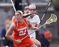 Syracuse University attacker/midfielder Kayla Treanor (21) on the attack.   Syracuse University (orange) defeated Boston College (white), 17-12, on the Newton Campus Lacrosse Field at Boston College, on March 27, 2013.