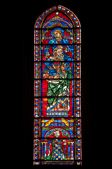 Medieval Window of the South Transept of the Gothic Cathedral of Chartres, France- Circa 1225-30. A UNESCO World Heritage Site. This window was a donation of the Mauclerc family, the Counts of Dreux-Bretagne, who are depicted with their arms in the bases of the lancets above it shows one of the four evangelists sitting on the shoulders of four Prophets - a rare literal illustration of the theological principle that the New Testament builds upon the Old Testament.