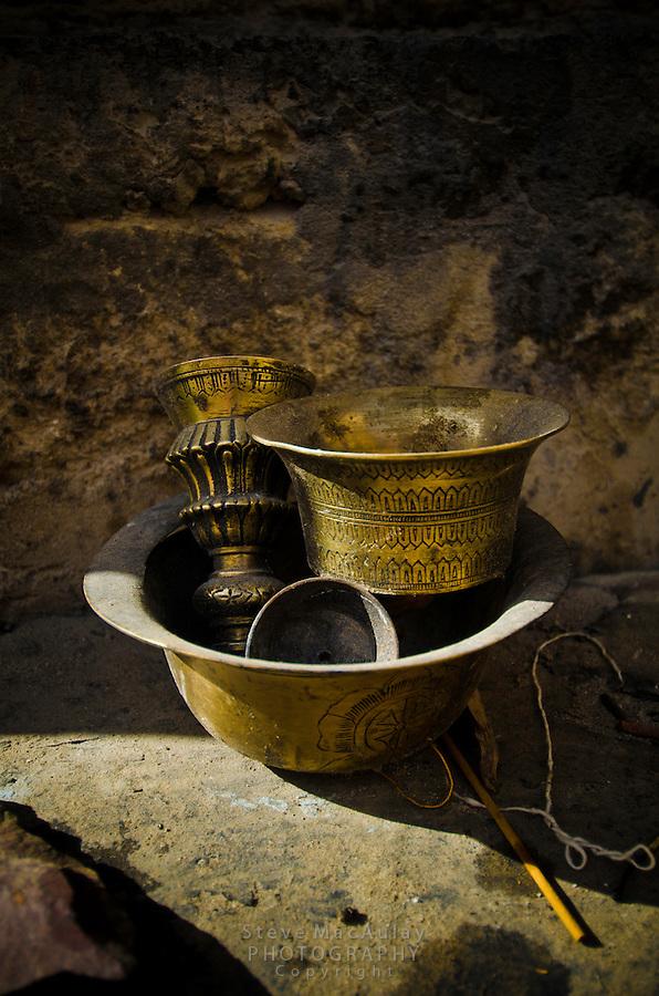 Brass oil lamp pieces at the Shey Palace Naropa Royal Palace, Leh, Ladakh, India
