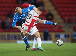 St Johnstone v Hamilton Accies...04.01.15   SPFL<br /> Steven Anderson gets to grips with Mikael Antoine Curier<br /> Picture by Graeme Hart.<br /> Copyright Perthshire Picture Agency<br /> Tel: 01738 623350  Mobile: 07990 594431