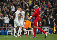 Real Madrid's French forward Karim Benzema and James Rodriguez celebrating after scoring during the UEFA Champions League match between Real Madrid and Borussia Dortmund at the Santiago Bernabeu Stadium in Madrid, Tuesday, December 7, 2016.