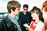 Marie Kierans from the Drogheda Independent interviewing Noel Gallagher from Oasis during the REM concert in Slane Castle 1995 <br /> Picture: Fran Caffrey/www.newsfile.ie NEWSFILE ARCHIVE