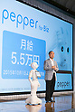 (L to R) Robot Pepper and SoftBank Chairman and CEO Masayoshi Son present the first quarter earnings (April-June 2015) for SoftBank Group Corp. at the Prince Hotel in Tokyo, Japan, August 6, 2015. SoftBank Group reported a rise in operating profits to 343.6 billion yen ($2.75 billion) from 319.4 billion a year ago. Mr. Son said net profit rose to 213.38 billion ($1.71 billion) nearly triple the 77.57 billion reported a year earlier. This is the first time that Son has shared microphones with a robot to report earnings. (Photo by Rodrigo Reyes Marin/AFLO)