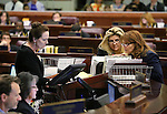 Nevada Assembly Chief Clerk Susan Furlong, left, talks with Assemblywoman Michele Fiore, R-Las Vegas, center, and Minority Leader Marilyn Kirkpatrick, D-North Las Vegas, in the final minutes of the session at the Legislative Building in Carson City, Nev., on Monday, June 1, 2015. <br /> Photo by Cathleen Allison