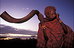 A Maasai moran blows an Ikudu horn durng an initiation ceremony that will bring the young maasai men into manhood. The blowing of this horn put some of the moran into a trance .<br /> Kajiado, Kenya.