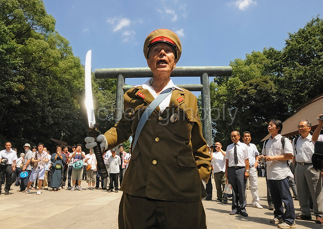 Men dressed in military garb march to offer prayer at Yasukuni Shrine in Tokyo on Saturday 15 Aug. 2009. Wartime prime minister Hideki Tojo is enshrined inside the controversial shrine together with 13 other convicted war criminals. Aug. 15 marks the 64th anniversary of Japan's surrender in the Pacific War.