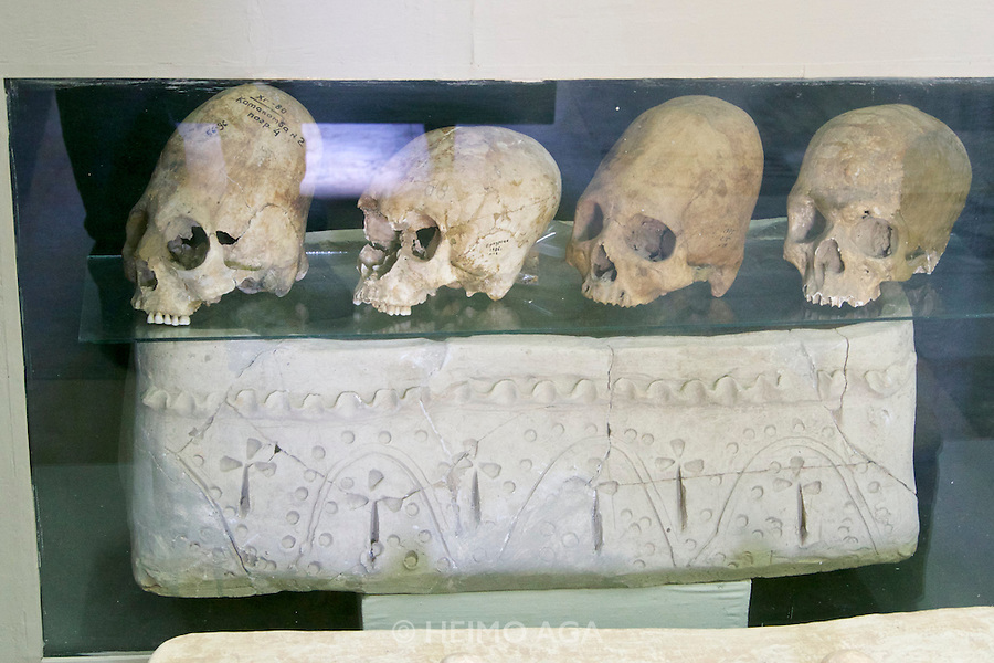 Uzbekistan, Samarqand. The museum at Afrosiab (Afrosiyob) excavation site. Bound skulls.