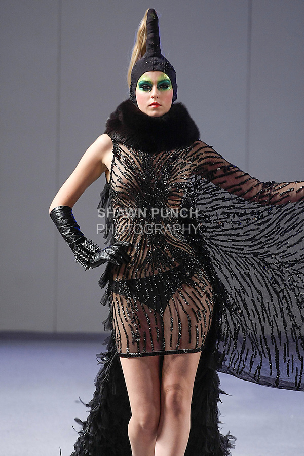 Model walks runway in an outfit from the Catalin Botezatu Spring Summer 2013 Domina collection, during Couture Fashion Week New York Spring 2013, on September 17, 2012.