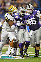 Kansas State running back Charles Jones (24) prevented from rushing by UCLA defensive lineman Ellis McCarthy (90) during first half of Alamo Bowl, Friday, January 02, 2015 in San Antonio, Tex. UCLA leads Kansas State 31-6 at the halftime. (Mo Khursheed/TFV Media via AP Images)