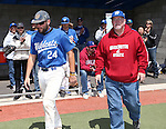 Western Nevada College's Spenser Dorsey escorts his dad onto the field for Sophomore Day festivities at John L. Harvey field, on Sunday, April 27, 2014, in Carson City, Nev.<br /> Photo by Cathleen Allison/Nevada Photo Source