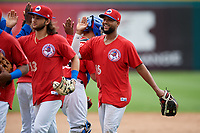Buffalo Bisons Richard Urena (16) and Bo Bichette (13) high five teammates after an International League game against the Indianapolis Indians on June 20, 2019 at Sahlen Field in Buffalo, New York.  Buffalo defeated Indianapolis 11-8  (Mike Janes/Four Seam Images)