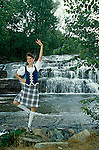 Highland dancer before waterfall