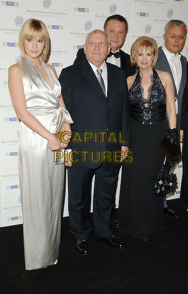ANASTASIA VIRGANSKAYA, MIKHAIL GORBACHEV & IRINA VIRGANSKAYA.Arrivals at the Russia Midsummer Fantasy in aid of the Raisa Gorbachev Foundation, Stud House, Hampton Court, Richmond upon Thames, London, England, June 7, 2008..full length family white silk satin long dress black suit glasses.CAP/DS.©Dudley Smith/Capital Pictures