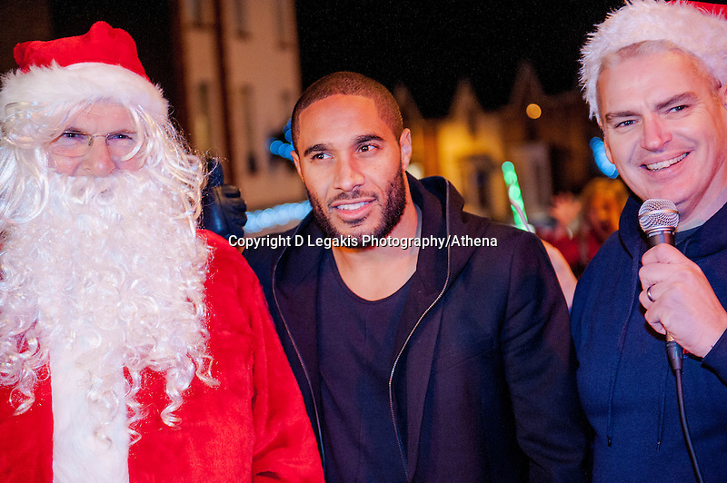 Thursday 20 November 2014<br /> Pictured: Ashley Williams and wales Rugby Captain Alun Wyn Jones help Santa Turn on the Mumbles christmas lights <br /> Re: Swansea City Captain Ashley Williams helps turn on the Christmas Lights at The Mumbles, Near Swansea, Wales UK