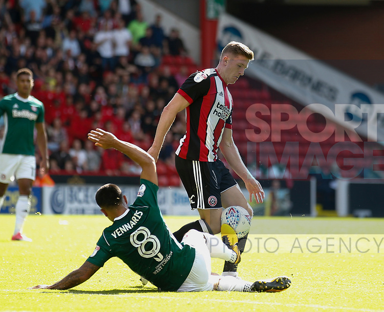 John Lundstram of Sheffield Utd  tackles by Nico Yennaris of Brentford during the English Championship League match at Bramall Lane Stadium, Sheffield. Picture date: August 5th 2017. Pic credit should read: Simon Bellis/Sportimage