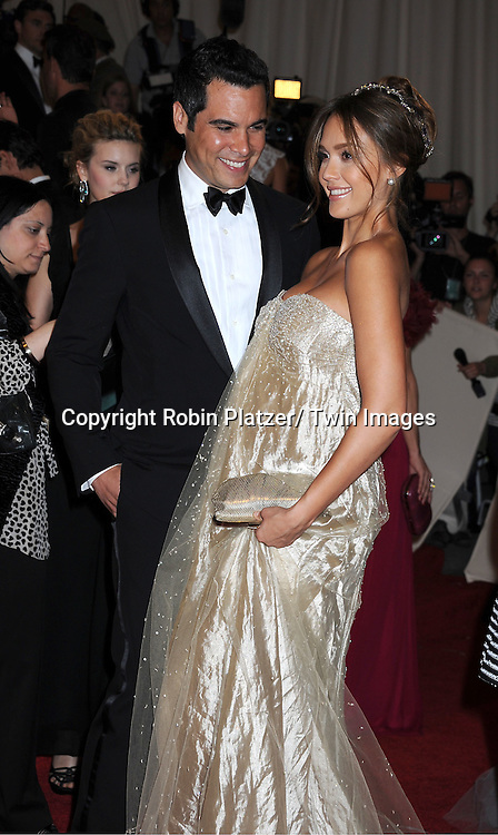 """Jessica Alba and husband Cash Warren arriving at The Costume Institute Gala Benefit celebriting """"Alexander McQueen: Savage Beauty"""" at The Metropolitan Museum of Art in New York City on May 2, 2011."""