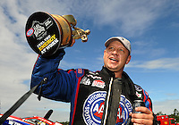 Mar. 12, 2012; Gainesville, FL, USA; NHRA funny car driver Robert Hight celebrates after winning the Gatornationals at Auto Plus Raceway at Gainesville. The race is being completed on Monday after rain on Sunday. Mandatory Credit: Mark J. Rebilas-