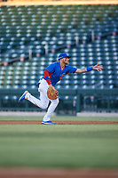 AZL Cubs 2 first baseman Abraham Rodriguez (12) underhands a ball to the pitcher covering the base during an Arizona League game against the AZL Dbacks on June 25, 2019 at Sloan Park in Mesa, Arizona. AZL Cubs 2 defeated the AZL Dbacks 4-0. (Zachary Lucy/Four Seam Images)