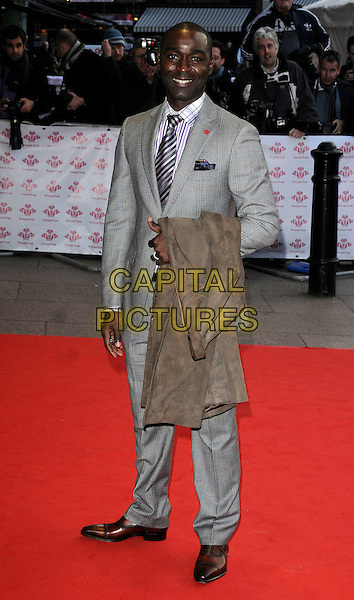 ANDREW COLE .The Prince's Trust Celebrate Success Awards at Odeon Leicester Square, London, England, March 1st, 2010. .arrivals full length grey gray suit tie striped plaid checked check  .CAP/CAN.©Can Nguyen/Capital Pictures.