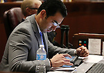 Nevada Sen. Ruben Kihuen, D- Las Vegas, works on the Senate floor during the second day of a special session at the Nevada Legislature, in Carson City, Nev., on Thursday, Sept. 11, 2014. Lawmakers are considering a complex deal to bring Tesla Motors to Nevada. (AP Photo/Cathleen Allison)