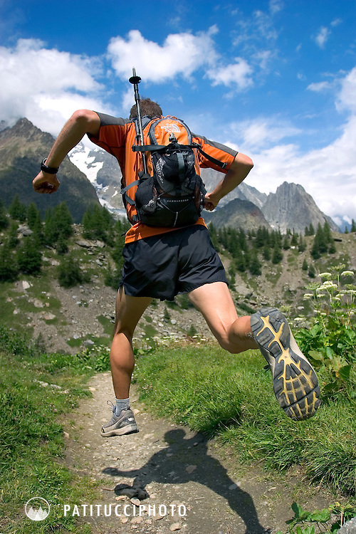 Topher Gaylord running above Lac Combal during a three day run of the Tour of Mont Blanc