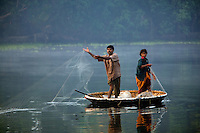 January 29th, 2008_Kerala State, India_ Fisherman cast their nets at sunrise, in an area of the backwaters which is located in the Southern Indian state of Kerala.  The waterways are a signature attraction in Kerala and are also an important link for communities and commerce there.  Photographer: Daniel J. Groshong/Tayo Photo Group