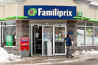 A woman exits a Familiprix drugstore in Quebec city January 4, 2010. Familiprix is a Canadian group of independent pharmacists.